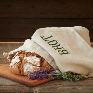 """Brotsack aus Leinen, mit Aufschrift """"Brot"""" in dem Brot verpackt ist"""